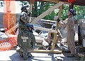 U.S. Marines with the Chemical Biological Incident Response Force use wooden brace to help support a steel beam in a collapsing building as part of exercise Vibrant Response 13 at the Muscatatuck Urban Training 120729-A-AC168-002.jpg