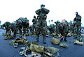 U.S. Navy Seabees assigned to Naval Mobile Construction Battalion 1 don their MCU-2P gas masks at the Naval Construction Battalion Center in Gulfport, Miss., Oct 081024-N-LD343-002.jpg