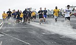 U.S. Sailors and Marines take part in a 5K run on the flight deck of the aircraft carrier USS Nimitz (CVN 68) Aug. 18, 2013, in the U.S. 5th Fleet area of responsibility 130818-N-IB033-275.jpg