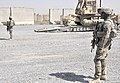 U.S. Soldiers with the 2nd Battalion, 23rd Infantry Regiment provides security as a bulldozer is unloaded at an Afghan National Army (ANA) checkpoint in the Panjwai district, Kandahar province, Afghanistan 130522-A-MX357-033.jpg