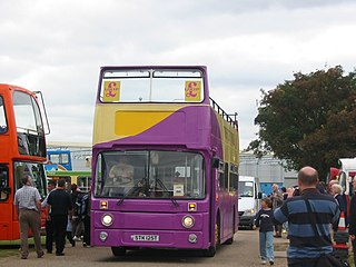 Open-top bus in UKIP yellow and purple colours