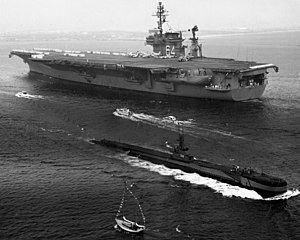 USS Constellation (CVA-64) and Baya (AGSS-318) 1962.jpeg
