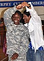 US Army 53061 1st Sgt. Jeanette Short, first sergeant Headquarters and Headquarters Company, 15th Special Troops Battalion, 15th Sustainment Brigade, dances with Alex Cruz, logistics warehouse contractor and Salsa.jpg