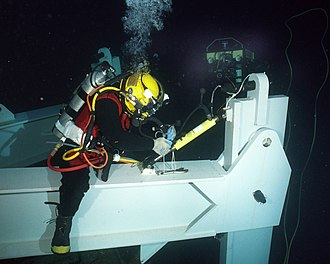 Saturation diving - Saturation diver conducts deep sea salvage operations.