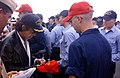 US Navy 021009-N-9964S-009 Joe Perry, a member of the internationally renowned rock band Aerosmith, signs a ball cap.jpg