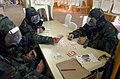 US Navy 030315-N-4309A-004 Navy Seabees are in a modified mission orientated protective posture (MOPP) level-3 while they play cards to pass the time during a recent Chemical, Biological, and Radiological (CBR) training exercis.jpg