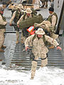 US Navy 030322-N-1050K-012 Marine Pfc. West jumps from a Landing Craft Utility vessel onto the dry land of Camp Patriot.jpg
