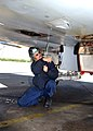 US Navy 030410-N-7535G-015 Aviation Electrician's Mate 1st Class Frank J. Puydak prepares to work on a drive unit, on an F-A 18 Hornet.jpg