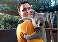 US Navy 030629-N-6197C-002 nformation Technician 2nd Class Jason A. Scott assigned to the amphibious assault ship USS Boxer (LHD 4), holds a koala bear at the Billabong Sanctuary in Townsville, Australia.jpg