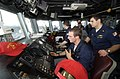 US Navy 031106-N-8590G-003 Master helmsman Seaman Colt Amborn guides USS Vandegrift (FFG 48) safely through the ocean under the support of the guided missile frigate's helm safety officer Mike Sauedra.jpg