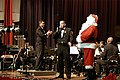 US Navy 041219-N-1194D-106 Musician 2nd Class Tommy Horner welcomes Santa Claus to the stage during a holiday concert.jpg