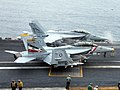 US Navy 050714-N-0000I-004 F-A-18F Super Hornets prepare to launch from the flight deck aboard the USS Abraham Lincoln (CVN 72).jpg