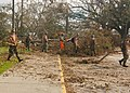 US Navy 050912-N-9274T-006 Seabees assigned to Naval Mobile Construction Battalion Four Zero (NMCB 40) out of Port HUENEME Calif., clears away debris around the Plaquemine Parish Post Office in Louisiana in support of Hurrican.jpg