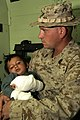 US Navy 051119-M-7747B-002 U.S. Navy Hospitalman Timothy P. Granger holds a three-year-old Pakistani boy during a medical evacuation.jpg