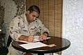 US Navy 060309-N-3207B-003 Culinary Specialist 3rd Class Ricardo Harp assigned to Patrol Squadron Four Seven (VP-47) participates in the E-5 Navy-wide Advancement Exam.jpg