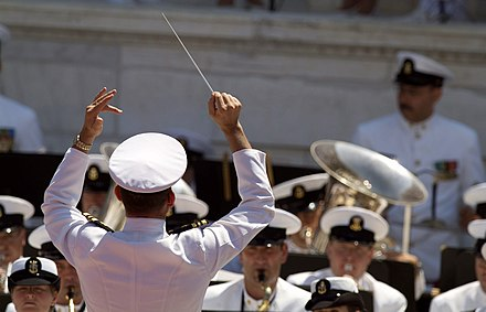 A military conductor leads the U.S. Navy band during Memorial Day ceremonies held at Arlington National Cemetery. US Navy 060529-N-2383B-123 The U.S. Navy band performs during Memorial Day ceremonies held in the amphitheater of Arlington National Cemetery.jpg