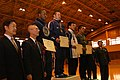 US Navy 070304-N-8854R-731 Builder 3rd Class Tyrone Huffin from Paterson, N.J., accepts his award for 2nd place in the heavyweight competition at the Japanese Self Defense Force All-Military Wrestling Tournament in Asaka.jpg