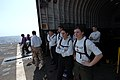 US Navy 070605-N-3729H-006 Sailors await medical supplies aboard the amphibious transport dock USS Denver (LPD 9).jpg