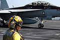 US Navy 070615-N-0890S-044 Lt. Regina Rogers watches as an F-A-18F Super Hornet taxis to the catapult aboard nuclear-powered aircraft carrier USS Nimitz (CVN 68).jpg