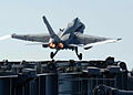 US Navy 070712-N-5384B-101 An F-A-18C Hornet, assigned to the Fighting Vigilantes of Strike Fighter Squadron (VFA) 151, takes off from the bow of the Nimitz-class aircraft carrier USS Abraham Lincoln (CVN 72) during flight oper.jpg