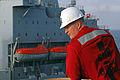 US Navy 070915-N-7643B-002 t. Chad Hollinger watches as Military Sealift Command fleet replenishment oiler USNS Yukon (T-AO 202) pulls alongside amphibious assault ship USS Tarawa (LHA 1) during an underway replenishment.jpg