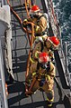 US Navy 071219-N-1831S-061 During a general quarters drill crewmembers aboard the guided-missile frigate USS Carr (FFG 52) charge the hoses as they head towards the fire.jpg