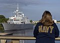 US Navy 080820-N-7090S-362 Civilians watch as the littoral combat ship USS Freedom (LCS 1) approaches the Menekaunee draw bridge.jpg