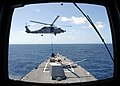 US Navy 080910-N-7197F-087 An SH-60B Sea Hawk helicopter conducts a vertical replenishment.jpg
