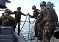 US Navy 090305-N-5366K-145 A Special Warfare Combatant-craft Crewman candidate passes a tow-line to an assisting rigid-hull inflatable boat crew.jpg