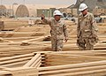 US Navy 090518-N-8547M-209 U.S. Marine Corps Capt. Joshua Guide, a company commander assigned to Naval Mobile Construction Battalion (NMCB) 5, speaks with Capt. Jeff Borowy, Commodore of the 25th Naval Construction Regiment.jpg
