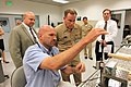 US Navy 090929-N-8863V-008 Engineering Technician Joseph Zinky, center, explains his work with a .50-caliber barrel erosion gage to Rear Adm. Kevin Quinn, commander, Naval Surface Force Atlantic.jpg