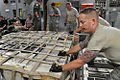 US Navy 091003-F-3798Y-586 Air Force Staff Sgt. Patrick Haney assigned to the 515th Air Mobility Squadron helps push a pallet into place aboard a C-17 Globmaster aircraft before departing Pago Pago, American Samoa.jpg
