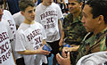 US Navy 100109-N-9268E-190 Special Warfare Operator 2nd Class Marvin Gonzalez, assigned to SEAL Team 8, speaks with students about job opportunities in the Navy.jpg