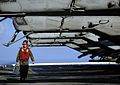 US Navy 100118-N-5345W-032 Lance Cpl. Timothy Smith, assigned to the Sabers of Marine Light Attack Helicopter Squadron (HMLA) 467 crosses the flight deck unde.jpg