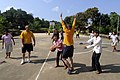 US Navy 100220-N-8335D-148 ailors assigned to the mine counter-measures ship USS Patriot (MCM 7) play basketball with orphans during a community service project.jpg