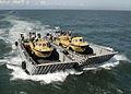 US Navy 100313-N-9301W-084 Landing craft mechanized transport vehicles to the amphibious dock landing ship USS Fort McHenry (LSD 43).jpg