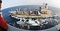 US Navy 100610-N-8913A-074 Midshipman 2nd Class Tyler Griffith watches as the Military Sealift Command fleet replenishment oiler USNS Leroy Grumman (T-AO 195) conduct replenishment.jpg