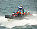 US Navy 100730-N-3349L-026 U.S. Coast Guardsmen and Sierra Leone Armed Forces personnel return to the USCGC Mohawk (WMEC 913).jpg
