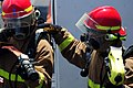 US Navy 110323-N-RC734-038 Sailors fight a simulated fire during a total ship survivability exercise.jpg