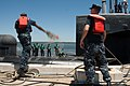 US Navy 110429-N-FG395-054 Seaman Andrew Burton, left, a line handler from the Blue crew of the guided-missile submarine USS Florida (SSGN 728), to.jpg