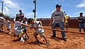 US Navy 110611-N-YU572-018 Hull Maintenance Technician 2nd Class Rob Leedham motivates cub scouts during a tug-of-war.jpg