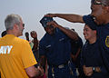 US Navy 110704-N-DU438-143 Ship's Serviceman 3rd Class Purnell Richardson, middle, shakes hands with Capt. Patrick Shea during a surprise promotion.jpg