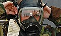 US Navy 111008-N-MW330-117 Hull Maintenance Technician Fireman Recruit Alexander Huntress dons his gas mask while participating in advanced chemica.jpg