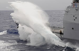 US Navy 111224-N-RG587-414 waves break over the USS Bunker Hill.jpg