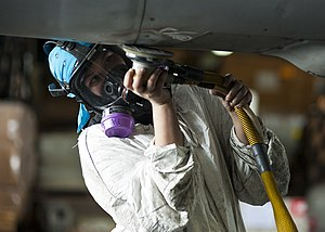 US Navy 120201-N-BT887-161 Aviation Structural Mechanic Airman Holly Harris sands the fuselage of an F-A-18E Super Hornet from the Tophatters of St.jpg