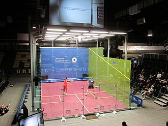 Squash (sport) - The glass show court used at the 2011 US Open Squash Championships hosted by Drexel University at the Daskalakis Athletic Center.  2 points during the Semi Final between James Willstrop and Nick Matthew in 2011  :