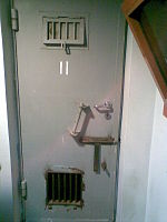 Underground prison cell in Egyptian SS HQ.jpg