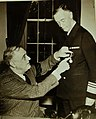 Vice Admiral Wilson Brown receives the Distinguished Service Medal from President Roosevelt, 1942 (23317700579).jpg
