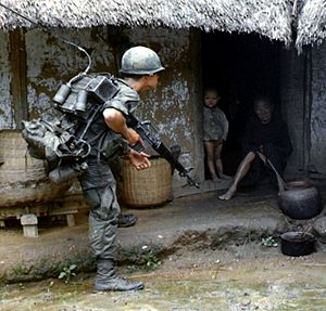 Search and destroy - US soldiers search Vietnamese homes for Vietcong guerrillas.