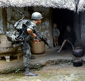 Search and destroy - US soldiers search Vietnamese homes for Viet Cong guerrillas.